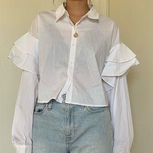 White ruffled button-up shirt